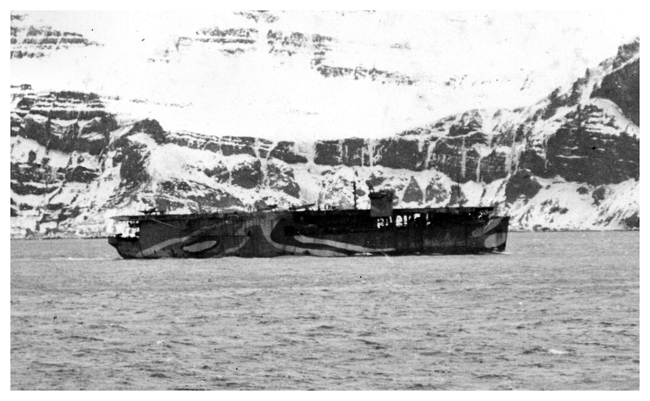 HMS Dasher at Hvalfjord, Iceland in February 1943 with convoy JW53. Photo is taken from the deck of the cruiser HMS Belfast.  Photo: From the collection of Sub-Lieutenant (A) John Vallely RNVR