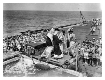 'Crossing the Line' in November 1945; The 'Pollywogs' (those who have not crossed the equator before) get their ritual ducking during the ceremony while on rout to Melbourne.  Photo:  Courtesy John Browne.