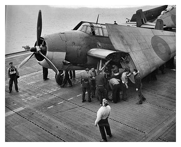 Avenger ('4H') of 850 Sqdn is moved by hand off the forward elevator onto  the flight deck of HMS Empress February 17th 1944.Photo:   CFB Esquimalt Naval & Military  Museum, VR995.30.15