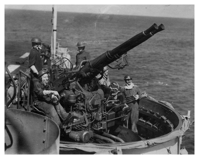 Action Stations- One of Emperor's 40mm Bofors gun crew closed up as the ship's defences are put through their paces. Photo: Jack Price via Carl Berrington