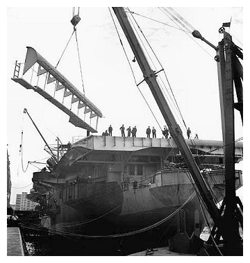 HMS Ranee has her round-down removed ready for the lengthening of her flight deck in Burrards dockyard, Vancouver. Photo: Ronny Jaques / National Film Board of Canada. Photothèque / Library and Archives Canada