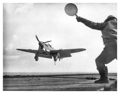 A Firefly is guided onto the deck by the Deck Landing Control Officer during a DLT period.  Photo: Courtesy of Terry Oxley