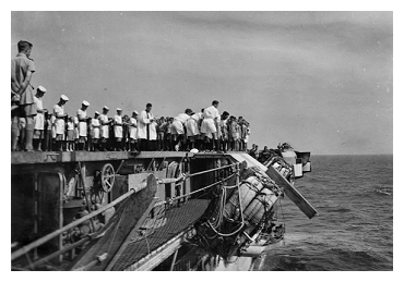 The burial at sea of Petty Officer Mitchell one of the casualties transferred from  HMS Indefatigable, he died on board Slinger on April 6th 1945 as the ship departed the refuelling area to return to Leyte.  Photo: Courtesy of David Yates